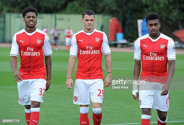 Chuba Akpom Granit Xhaka and Alez Iwobi of Arsenal during the Arsenal Squad photos at London Colney on September 21 2016 in St Albans England