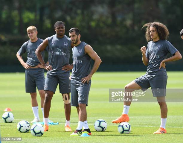 Chuba Akpom Henrikh Mkhitaryan and Matteo Guendouzi of Arsenal during a training session at London Colney on July 16 2018 in St Albans England