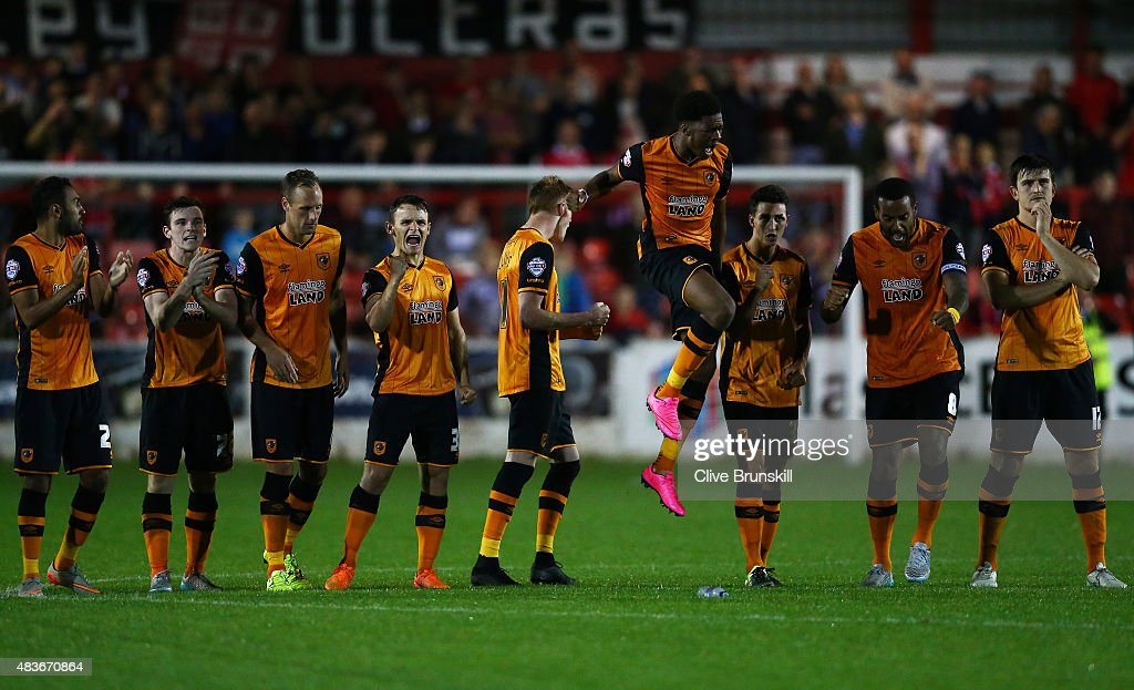 Chuba Akpom leaps above his team mates to celebrate in the penalty shoot out during the Capital One Cup First Round match between Accrington Stanley and Hull City at Wham Stadium on August 11, 2015 in Accrington, England.