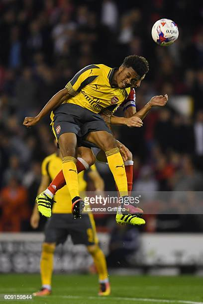 Chuba Akpom of Arsenal and Chris Cohen of Nottingham Forest in action during the EFL Cup Third Round match between Nottingham Forest and Arsenal at...