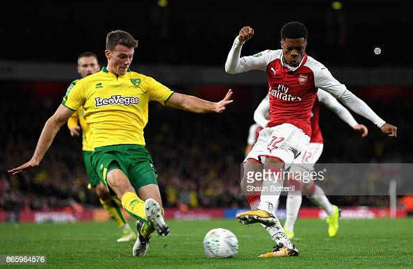 Chuba Akpom Of Arsenal And Christoph Zimmermann Of Norwich