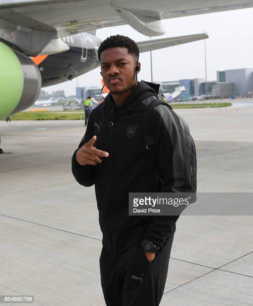 Chuba Akpom of Arsenal boards the plane at Luton Airport on September 27 2017 in Luton England