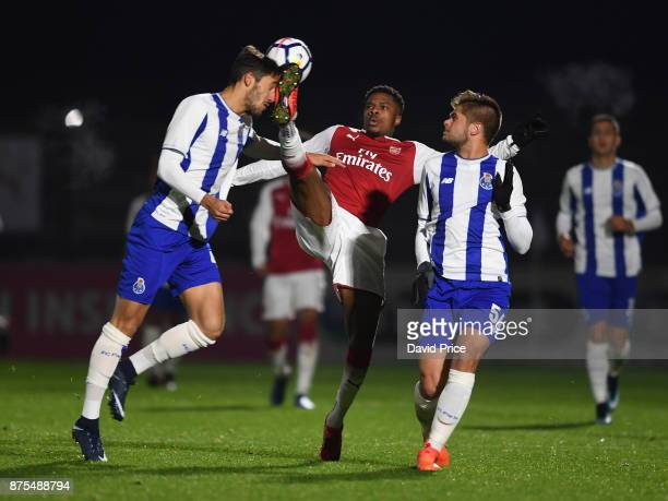 Chuba Akpom of Arsenal challenges Jorge Fernandes and Luiz Palhares of Porto during the match between Arsenal U23 and Porto at Meadow Park on...