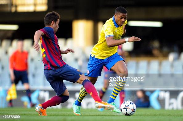 Chuba Akpom Of Arsenal Duels For The Ball With Juanma Of