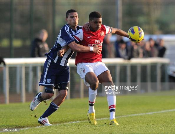 Chuba Akpom Of Arsenal Holds Off Bradley Garmston Of WBA