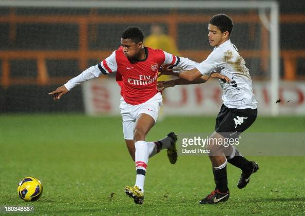 Chuba Akpom Of Arsenal Holds Off Liam Donnelly Of Fulham