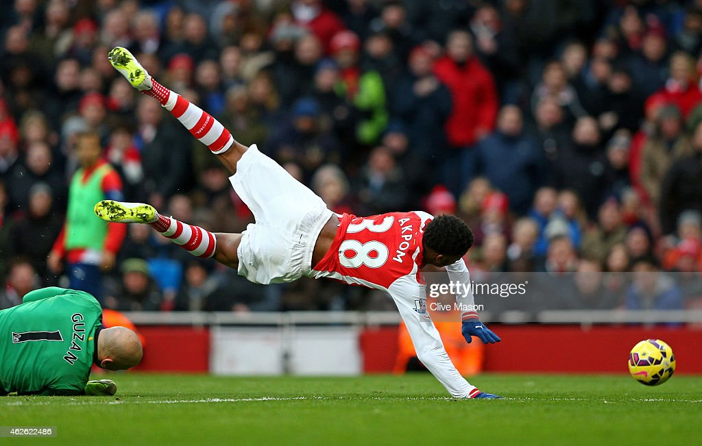 Chuba Akpom of Arsenal is brought down by goalkeeper Brad Guzan of Aston Villa to concede a penalty during the Barclays Premier League match between Arsenal and Aston Villa at the Emirates Stadium on February 1, 2015 in London, England.