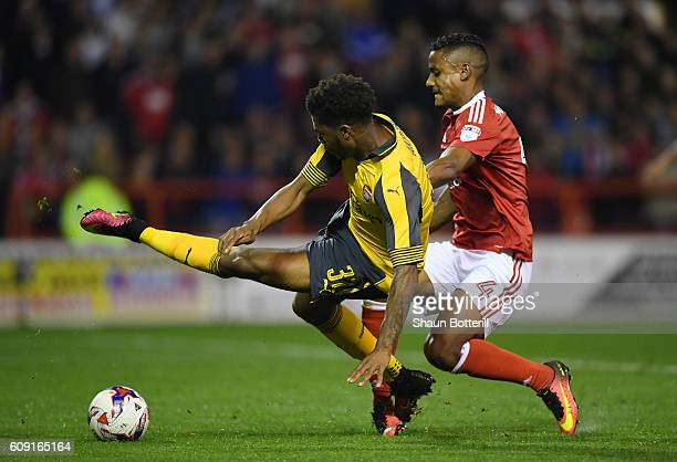 Chuba Akpom of Arsenal is brought down by Michael Mancienne of Nottingham Forest leading to a penalty during the EFL Cup Third Round match between...