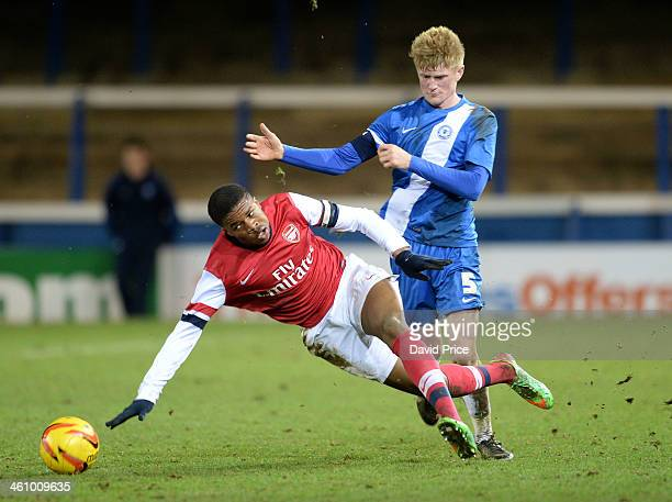Chuba Akpom of Arsenal is fouled by Joe Burgess of Peterborough during the match between Peterborough United U18 and Arsenal U18 in the FA Youth Cup...