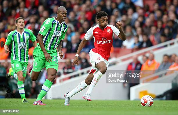 Chuba Akpom of Arsenal moves away from Naldo during the Emirates Cup match between Arsenal and VfL Wolfsburg at the Emirates Stadium on July 26 2015...