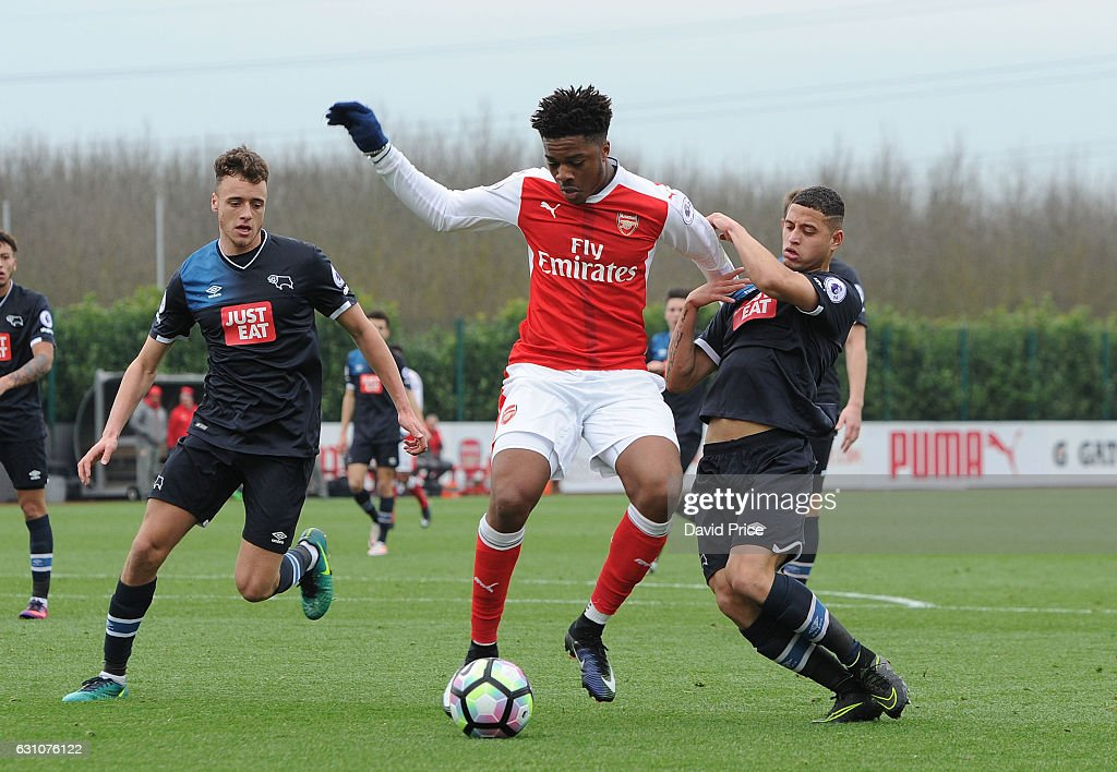 Chuba Akpom of Arsenal takes on Alefe Santos and Alex Cover of Derby during the match between Arsenal U23 and Derby County U23 at London Colney on January 6, 2017 in St Albans, England.