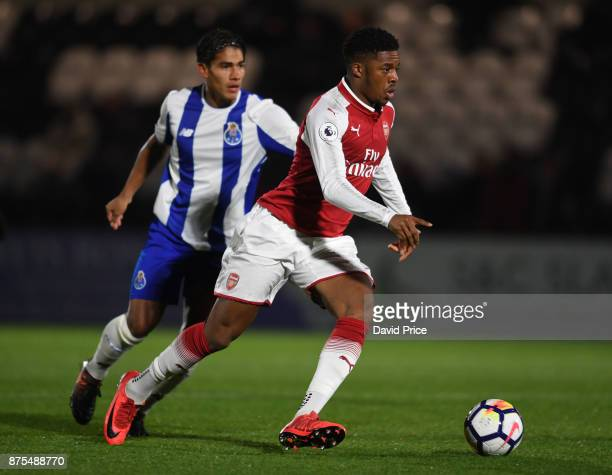 Chuba Akpom of Arsenal takes on Federico Varela of Porto during the match between Arsenal U23 and Porto at Meadow Park on November 17 2017 in...