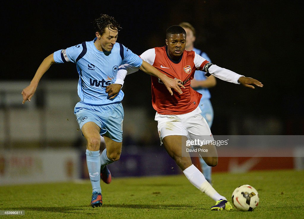 Chuba Akpom Of Arsenal Takes On Jake Hutchings Of Torquay