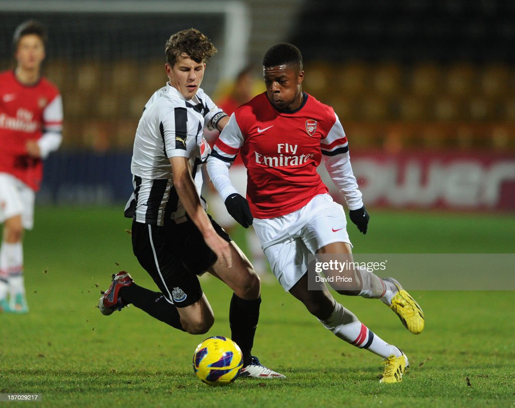 Chuba Akpom Of Arsenal Takes On Lubo Satka Of Newcastle