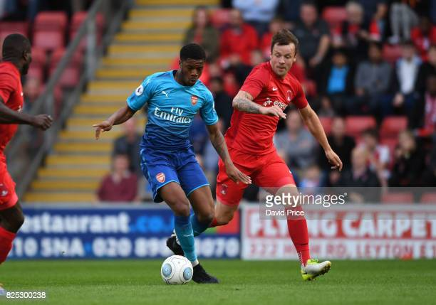 Chuba Akpom of Arsenal takes on Rian McLean of Leyton Orient during the match between Leyton Orient and Arsenal U23 at Brisbane Road on August 1 2017...