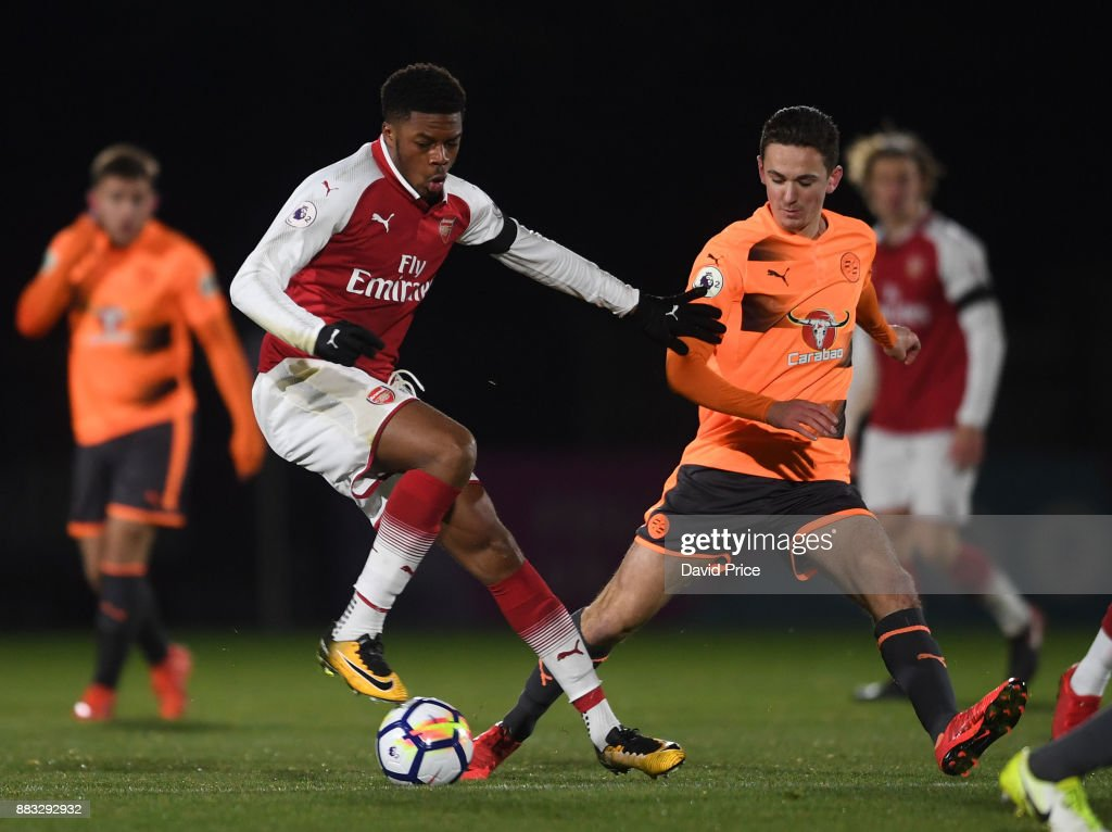 Chuba Akpom Of Arsenal Turns Away From Jordan Holsgrove Of