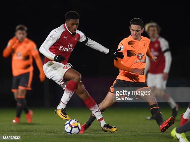 Chuba Akpom of Arsenal turns away from Jordan Holsgrove of Reading during the Premier League International Cup match between Arsenal and Reading at...