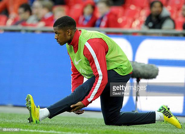 Chuba Akpom of Arsenal warms up during the match between Arsenal and Wigan Athletic in the FA Cup Semi Final at Wembley Stadium on April 12 2014 in...