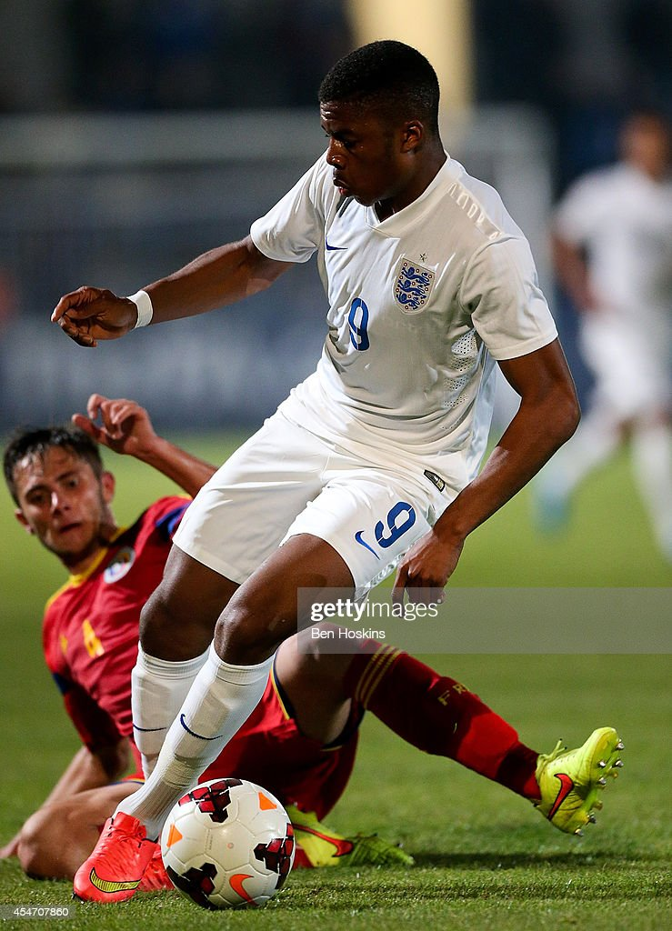 Chuba Akpom of England holds off the challenge of Marius Halmaghe of Romania during the U20 International friendly match between England and Romania on September 5, 2014 in Telford, England.