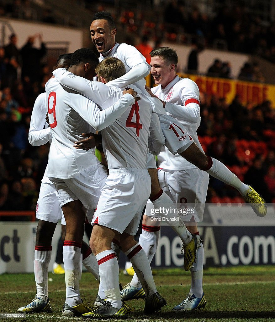 Chuba Akpom of England U19 is mobbed by his team-mates after scoring the opening goal during the International Match between England U19 and Denmark U19 at Keepmoat Stadium on February 5, 2013 in Doncaster, England.