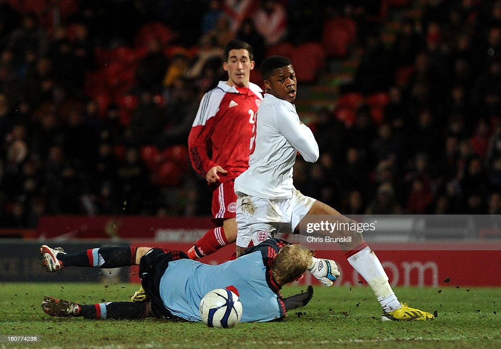 Chuba Akpom of England U19 scores his side's second goal past Oliver Korch of Denmark U19 during the International Match between England U19 and Denmark U19 at Keepmoat Stadium on February 5, 2013 in Doncaster, England.