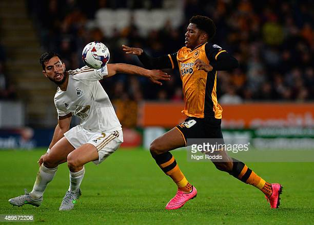 Chuba Akpom of Hull City and Jordi Amat of Swansea City tussle for the ball during the Capital One Cup third round match between Hull City and...