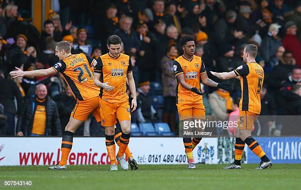 Chuba Akpom of Hull City celebrates scoring his team's first goal with his team mates during The Emirates FA Cup fourth round match at between Bury...