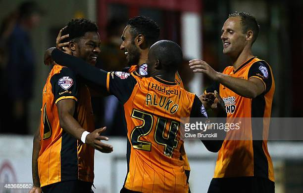 Chuba Akpom of Hull City celebrates with his team mate Ahmed El Mohamady after scoring the first goal in extra time during the Capital One Cup First...
