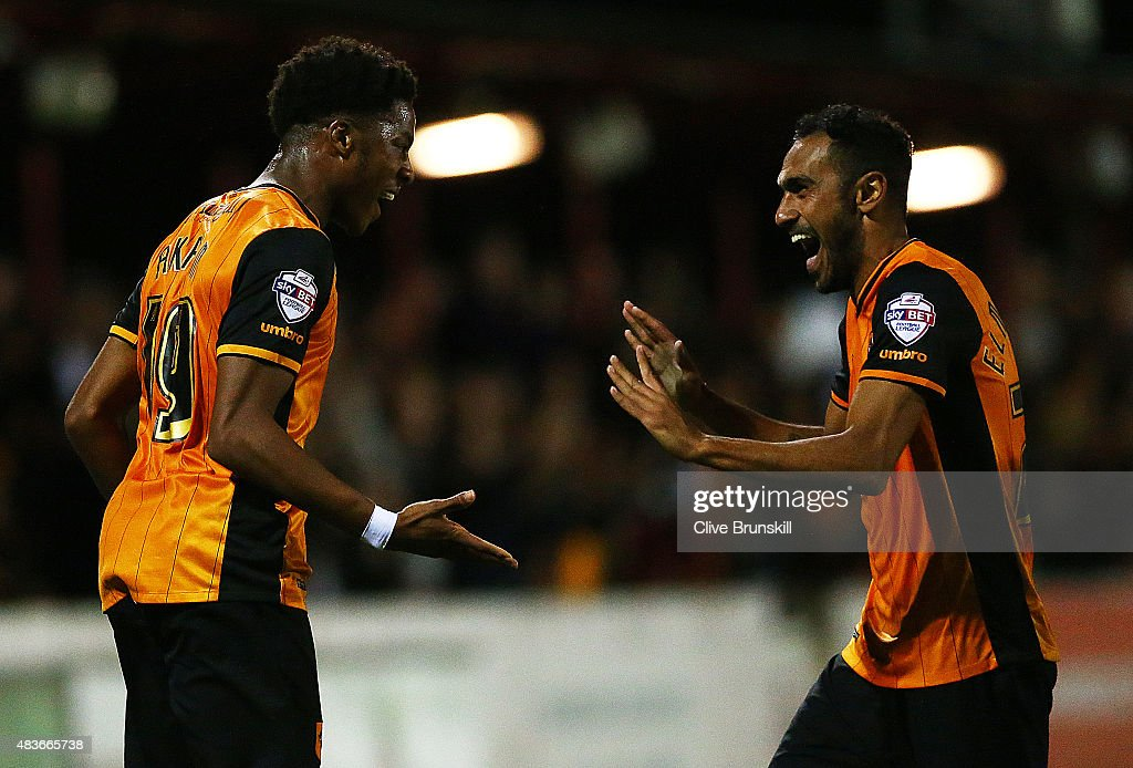 Chuba Akpom of Hull City celebrates with his team mate Ahmed El Mohamady after scoring the first goal in extra time during the Capital One Cup First Round match between Accrington Stanley and Hull City at Wham Stadium on August 11, 2015 in Accrington, England.