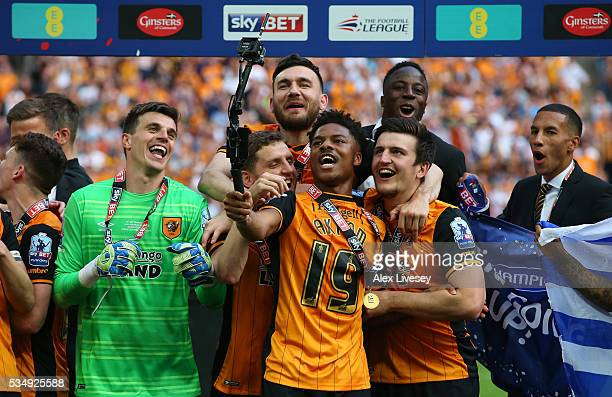 Chuba Akpom of Hull City takes a selfie as he celebrates with teammates after the Sky Bet Championship Play Off Final match between Hull City and...