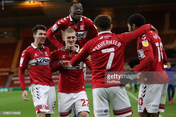 Chuba Akpom of Middlesbrough celebrates with his team mates after scoring their first goal during the Sky Bet Championship match between...