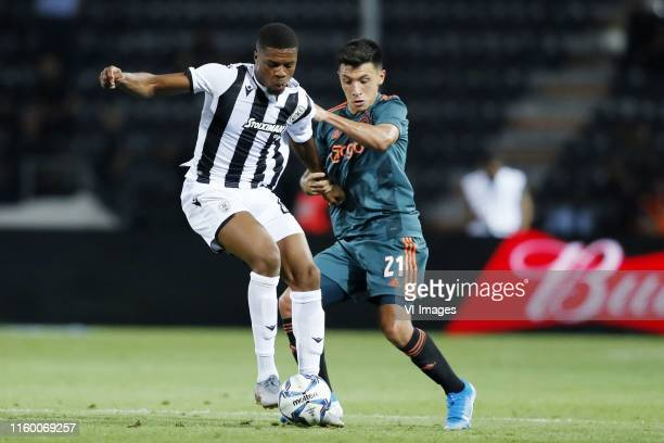 Chuba Akpom of PAOK FC, Lisandro Martinez of Ajax during the UEFA Champions League third round qualifying first leg match between PAOK FC and Ajax...
