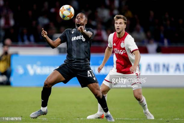 Chuba Akpom of PAOK Saloniki, Joel Veltman of Ajax during the UEFA Champions League match between Ajax v PAOK Saloniki at the Johan Cruijff Arena on...