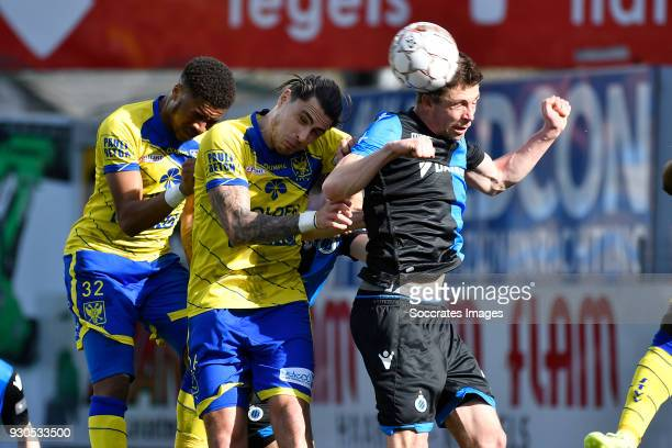 Chuba Akpom of Sint Truiden Jorge Teixeira of Sint Truiden Brandon Mechele of Club Brugge during the Belgium Pro League match between Sint Truiden v...