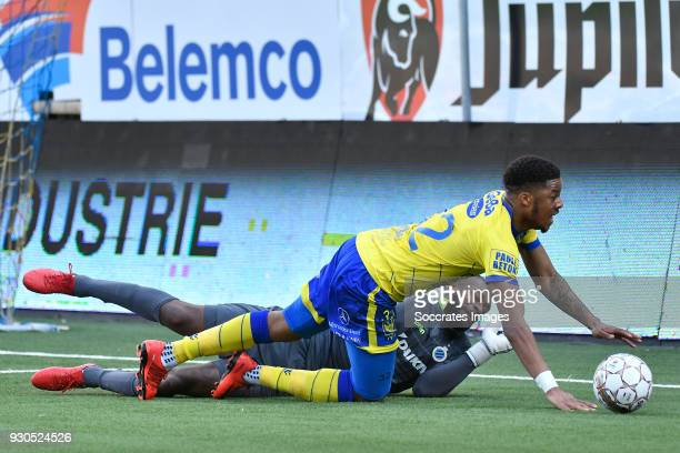 Chuba Akpom of Sint Truiden Kenneth Vermeer of Club Brugge during the Belgium Pro League match between Sint Truiden v Club Brugge at the Stayen on...