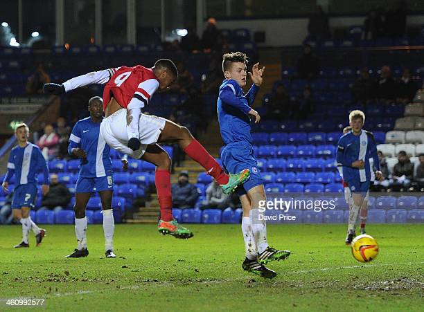 Chuba Akpom scores Arsenal's 2nd goal under pressure from Liam Marshall of Peterborough during the FA Youth Cup Fourth Round match between...