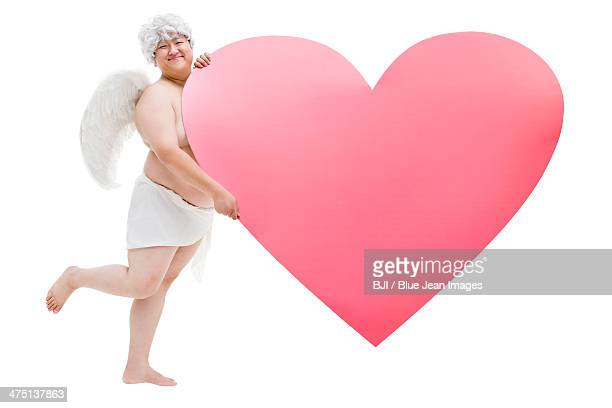 Chubby angel with a big heart shape