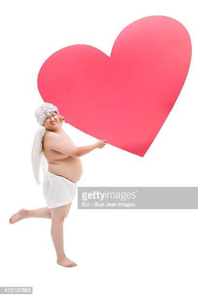 Chubby angel with a big heart shape