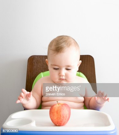 Chubby Baby Girl Sitting In High Chair Stock Photo Getty