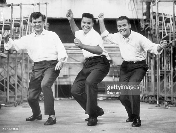 Chubby Checker leads Conway Twitty and Dick Clark through the dance the Twist, 7th September 1960.