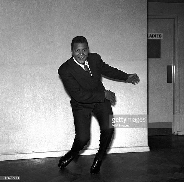 Chubby Checker posed in corridor doing the twist 1961