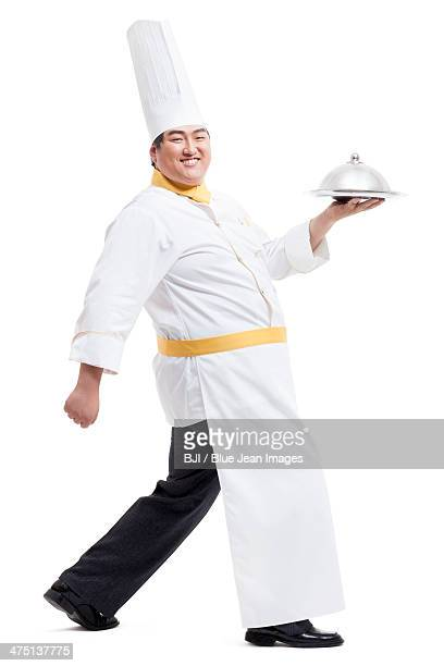 Chubby cook serving food