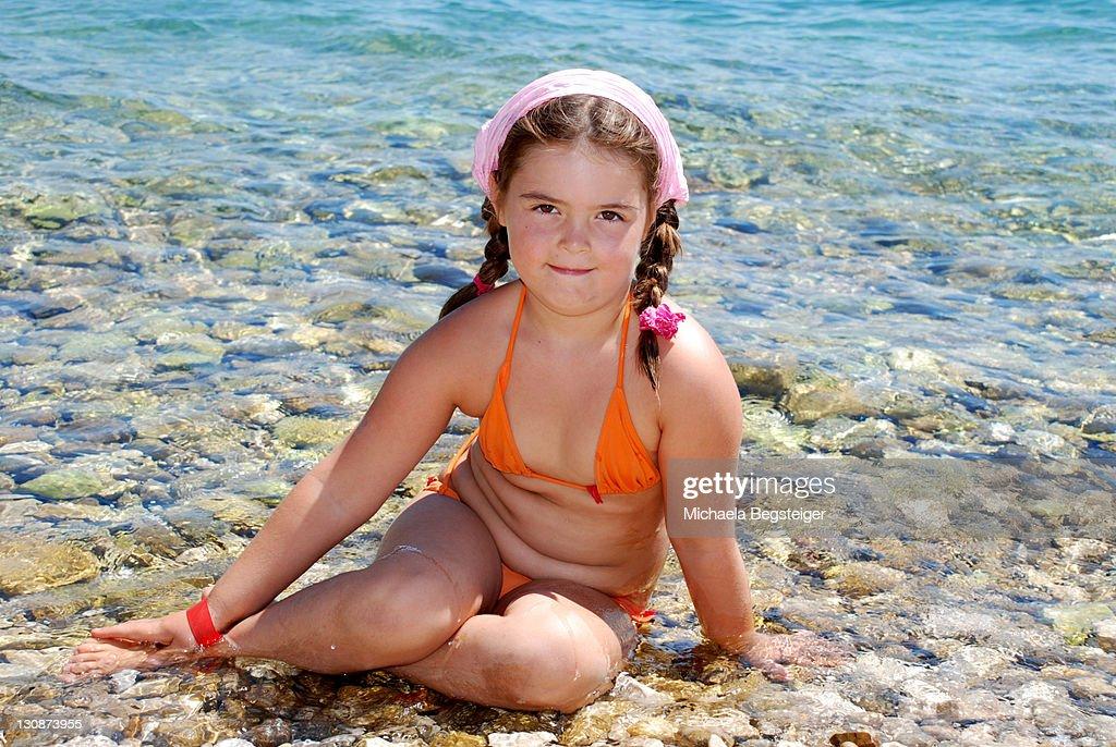 chubby girl at sea : Stock Photo