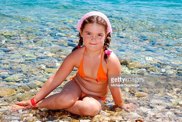 chubby girl at sea - thick girls stock photos and pictures