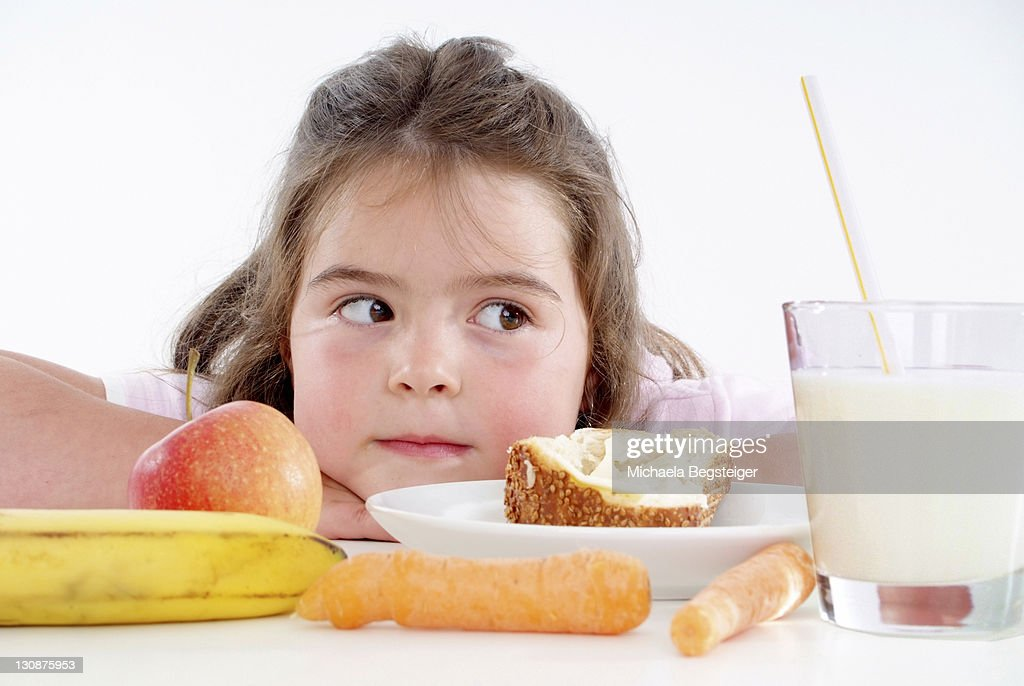 Chubby girl with healthy breakfast : Stock Photo