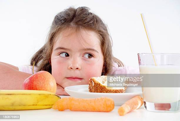 chubby girl with healthy breakfast - thick girls stock photos and pictures