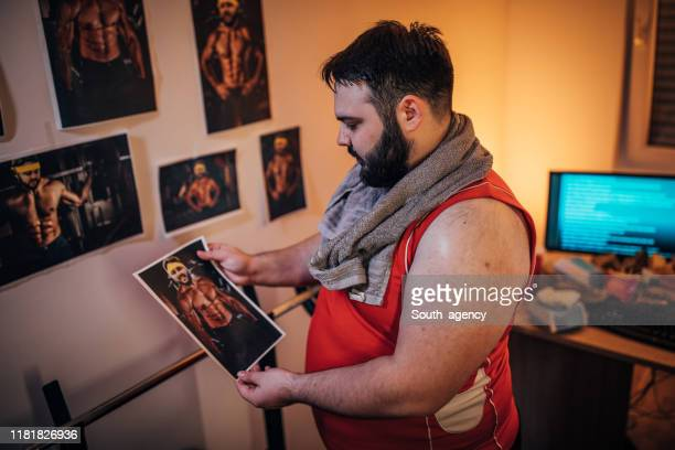 chubby guy wishing to be fit - unhealthy living stock pictures, royalty-free photos & images