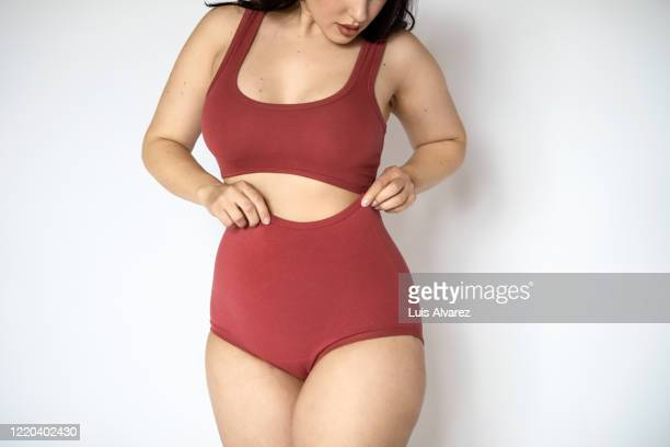chubby woman in lingerie on white background - femmes en culottes photos et images de collection
