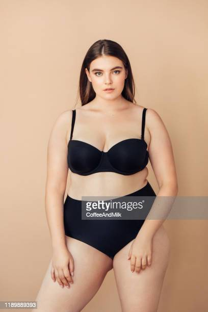 chubby young woman. plus size woman - chubby stock pictures, royalty-free photos & images