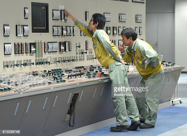 Chubu Electric Power Co officials join an emergency drill on Oct 18 in front of a simulator of the central control room for a reactor of the...